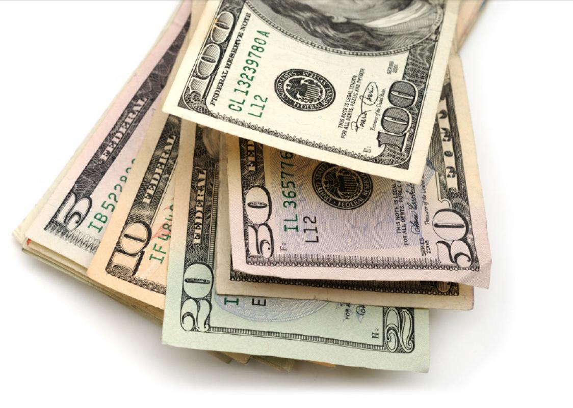 Dollar Bills laying on eachother